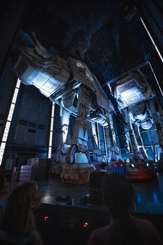 Guests race past massive AT-AT walkers aboard a First Order Star Destroyer as part of Star Wars: Rise of the Resistance, the groundbreaking new attraction opening Dec. 5, 2019, inside Star Wars: Galaxy's Edge at Disney's Hollywood Studios in Florida and Jan. 17, 2020, at Disneyland Park in California. (Matt Stroshane, photographer)