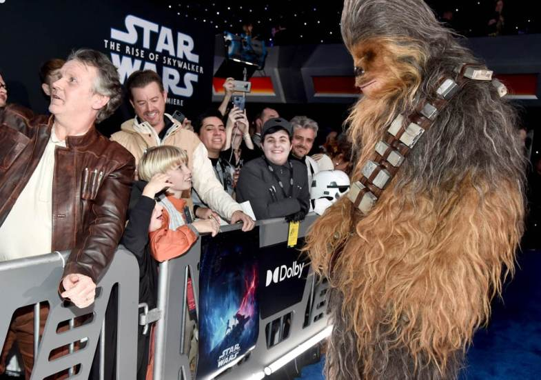 "HOLLYWOOD, CALIFORNIA - DECEMBER 16: Chewbacca arrives for the World Premiere of ""Star Wars: The Rise of Skywalker"", the highly anticipated conclusion of the Skywalker saga on December 16, 2019 in Hollywood, California. (Photo by Alberto E. Rodriguez/Getty Images for Disney)"