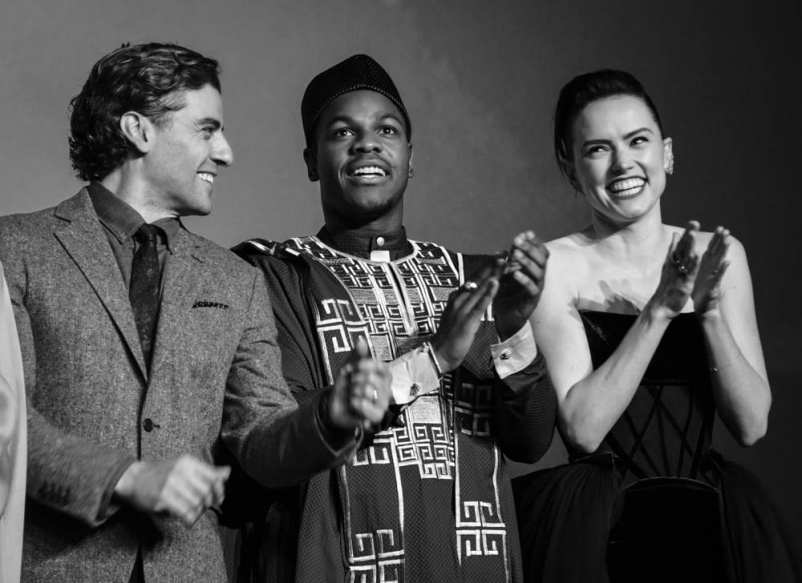 "LONDON, ENGLAND - DECEMBER 18: (EDITORS NOTE: Image has been converted to black and white) (L-R) Oscar Isaac, John Boyega and Daisy Ridley attend the European premiere of ""Star Wars: The Rise of Skywalker"" at Cineworld Leicester Square on December 18, 2019 in London, England. (Photo by Gareth Cattermole/Getty Images for Disney)"