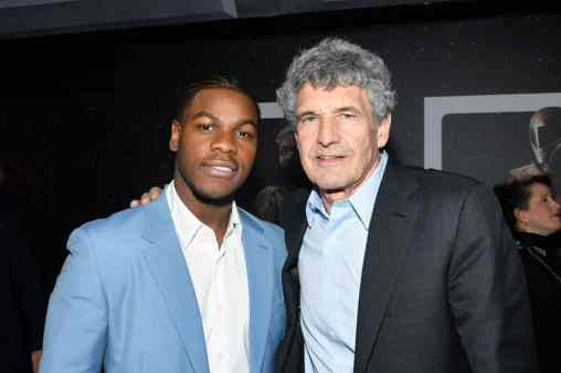 "HOLLYWOOD, CALIFORNIA - DECEMBER 16: (L-R) John Boyega and Co-Chairman and Chief Creative Officer of The Walt Disney Studios Alan Horn arrive for the World Premiere of ""Star Wars: The Rise of Skywalker"", the highly anticipated conclusion of the Skywalker saga on December 16, 2019 in Hollywood, California. (Photo by Amy Sussman/Getty Images for Disney)"