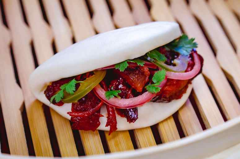 This char siu pork bao with barbecued pork, pickled red onions and jalapeño can be found at Disney California Adventure Park as Disneyland Resort celebrates the Year of the Mouse this Lunar New Year, Jan. 17 through Feb. 9, 2020. During the 24 days of this multicultural celebration, guests will enjoy exciting live entertainment and musical performances, plus inspired food and beverage items across festival marketplaces. (David/Nguyen Disneyland Resort)