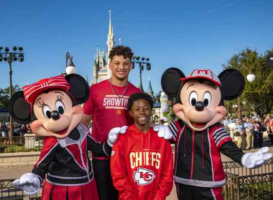 Kansas City Chiefs quarterback and Super Bowl MVP Patrick Mahomes shares a special memory with a Make-A-Wish child – 10-year-old Nathaniel from Texas – along with Mickey Mouse and Minnie Mouse on Monday, Feb. 3, 2020, at Walt Disney World Resort in Lake Buena Vista, Fla. Nathaniel and 17 other Make-A-Wish children whose wishes were to attend the Super Bowl joined in festivities as part of the traditional Super Bowl celebration at Magic Kingdom Park. Disney Parks previously announced it will donate $1 million to Make-A-Wish in honor of Mahomes' MVP performance and to make even more magical wishes come true in the future. Disney helps grant more than 10,000 wishes each year. (Matt Stroshane, Photographer)