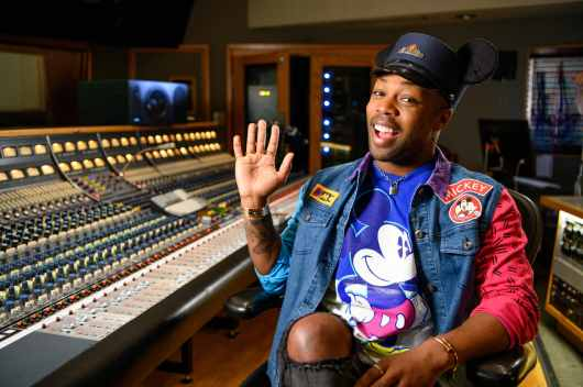 """Singer-songwriter Todrick Hall smiles for a photo while working on the music for the all-new """"Magic Happens"""" parade, which debuts at Disneyland Park on Feb. 28, 2020. """"Magic Happens"""" will feature an energetic musical score and new songs, co-composed by Hall. This new parade, led by Mickey Mouse and his pals, celebrates the awe-inspiring moments of magic that are at the heart of so many Disney stories. (Richard Harbaugh/Disneyland Resort)"""