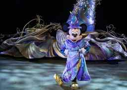 """Pictured during a backstage rehearsal of the """"Magic Happens"""" parade set to debut at Disneyland Park in California Feb. 28, 2020, Mickey Mouse will wear an all-new sorcerer-inspired costume as he leads the way from atop a 15-foot tall iridescent magical hat. The parade will come to life with an energetic musical score and new songs and will feature stunning floats, beautiful costumes and beloved Disney characters. (Joshua Sudock/Disneyland Resort)"""
