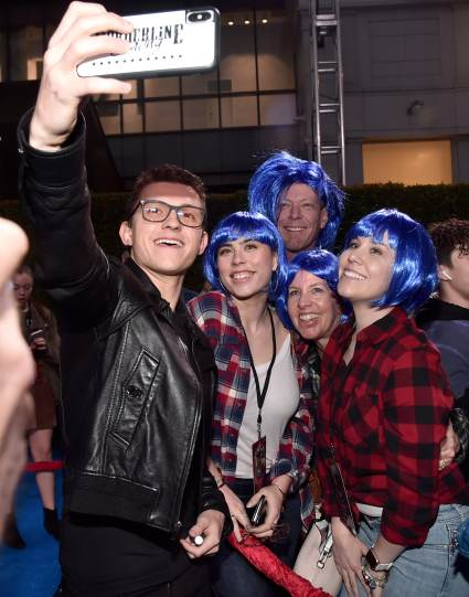 HOLLYWOOD, CALIFORNIA - FEBRUARY 18: Tom Holland poses with fans at the world premiere of Disney and Pixar's ONWARD at the El Capitan Theatre on February 18, 2020 in Hollywood, California. (Photo by Alberto E. Rodriguez/Getty Images for Disney)