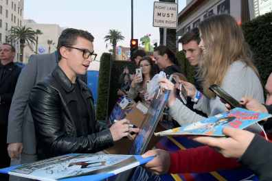 HOLLYWOOD, CALIFORNIA - FEBRUARY 18: Tom Holland signs autographs at the world premiere of Disney and Pixar's ONWARD at the El Capitan Theatre on February 18, 2020 in Hollywood, California. (Photo by Charley Gallay/Getty Images for Disney)