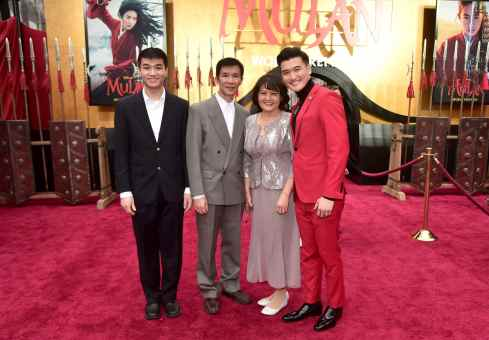 HOLLYWOOD, CALIFORNIA - MARCH 09: Chen Tang (R) and guests attend the World Premiere of Disney's 'MULAN' at the Dolby Theatre on March 09, 2020 in Hollywood, California. (Photo by Alberto E. Rodriguez/Getty Images for Disney)