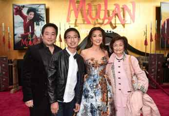 HOLLYWOOD, CALIFORNIA - MARCH 09: Ming-Na Wen (C) and guests attend the World Premiere of Disney's 'MULAN' at the Dolby Theatre on March 09, 2020 in Hollywood, California. (Photo by Alberto E. Rodriguez/Getty Images for Disney)