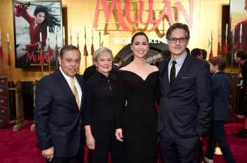 HOLLYWOOD, CALIFORNIA - MARCH 09: Producer Jason T. Reed (far R) and guests attend the World Premiere of Disney's 'MULAN' at the Dolby Theatre on March 09, 2020 in Hollywood, California. (Photo by Alberto E. Rodriguez/Getty Images for Disney)