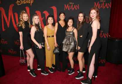 HOLLYWOOD, CALIFORNIA - MARCH 09: Ruthie Davis (C) and University of Delaware students attend the World Premiere of Disney's 'MULAN' at the Dolby Theatre on March 09, 2020 in Hollywood, California. (Photo by Jesse Grant/Getty Images for Disney)