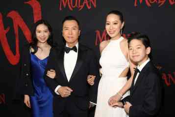 HOLLYWOOD, CALIFORNIA - MARCH 09: (L-R) Jasmine Yen, Donnie Yen, Cissy Wang, and James Yen attend the World Premiere of Disney's 'MULAN' at the Dolby Theatre on March 09, 2020 in Hollywood, California. (Photo by Jesse Grant/Getty Images for Disney)