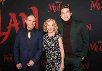 HOLLYWOOD, CALIFORNIA - MARCH 09: (L-R) David Coulson, Norelle Scott, and Maxton Scott attend the World Premiere of Disney's 'MULAN' at the Dolby Theatre on March 09, 2020 in Hollywood, California. (Photo by Jesse Grant/Getty Images for Disney)