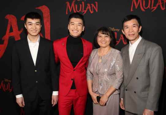 HOLLYWOOD, CALIFORNIA - MARCH 09: Chen Tang (2nd from L) and guests attend the World Premiere of Disney's 'MULAN' at the Dolby Theatre on March 09, 2020 in Hollywood, California. (Photo by Jesse Grant/Getty Images for Disney)