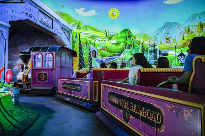 """Guests board Runnamuck Railroad and journey into Runnamuck Park as part of Mickey & Minnie's Runaway Railway, opening March 4, 2020, in Disney's Hollywood Studios at Walt Disney World Resort in Lake Buena Vista, Fla. The first ride-through attraction in Disney history featuring Mickey Mouse and Minnie Mouse brings guests into the vibrant world of """"Mickey Mouse"""" cartoon shorts. (Matt Stroshane, photographer)"""