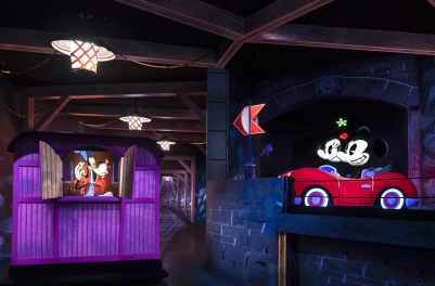 Engineer Goofy says hello to Mickey Mouse and Minnie Mouse in Mickey & Minnie's Runaway Railway, the new attraction opening March 4, 2020, in Disney's Hollywood Studios at Walt Disney World Resort in Lake Buena Vista, Fla. Guests hop aboard Runnamuck Railroad with Goofy as Mickey and Minnie search for the perfect picnic spot in their sporty red roadster in this new family-friendly adventure through a vibrant cartoon world. (Kent Phillips, photographer)
