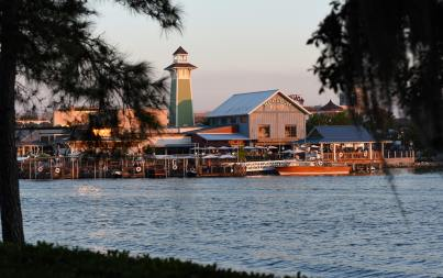 The BOATHOUSE: Great Food, Waterfront Dining, Dream Boats, is an upscale, waterfront dining experience in the heart of Disney Springs with a gourmet menu featuring steaks, chops, fresh seafood and a raw bar. The restaurant features spectacular floating artwork — dream boats from the 30's, 40's & 50's — and a unique opportunity for guests to take a Captain-guided tour aboard amphibious autos called Amphicars on Lake Buena Vista. The BOATHOUSE from Schussler Creative is located at The Landing at Disney Springs in Lake Buena Vista, Fla. (David Roark, photographer)