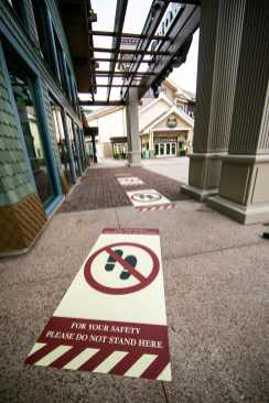 Ground signage at Disney Springs at Walt Disney World Resort in Lake Buena Vista, Fla., delineates appropriate physical distancing outside the World of Disney store. When Disney Springs reopens May 20, 2020, new health and safety protocols will be in place for guests visiting the shopping, dining and entertainment district – among them, maintaining proper physical distancing. (Olga Thompson, photographer)