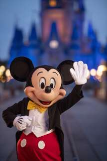 Mickey Mouse pauses on Main Street, U.S.A. just before sunrise prior to the phased reopening of Magic Kingdom Park, July 11, 2020, at Walt Disney World Resort in Lake Buena Vista, Fla. (Kent Phillips, photographer)
