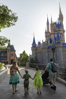 Guests walk toward Cinderella Castle at Magic Kingdom Park, July 11, 2020, at Walt Disney World Resort in Lake Buena Vista, Fla., on the first day of the theme park's phased reopening. (Matt Stroshane, photographer)