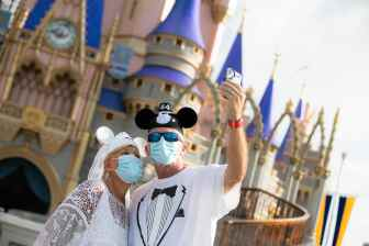 Guests stop to take a selfie at Magic Kingdom Park, July 11, 2020, at Walt Disney World Resort in Lake Buena Vista, Fla., on the first day of the theme park's phased reopening. (Olga Thompson, photographer)