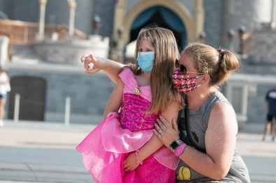 Guests visit Magic Kingdom Park, July 11, 2020, at Walt Disney World Resort in Lake Buena Vista, Fla., on the first day of the theme park's phased reopening. (Olga Thompson, photographer)