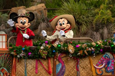 Mickey Mouse (left) and Minnie Mouse (right) sail down Discovery River as part of the holiday celebrations happening at Disney's Animal Kingdom at Walt Disney World Resort in Lake Buena Vista, Fla. (Kent Phillips, photographer)