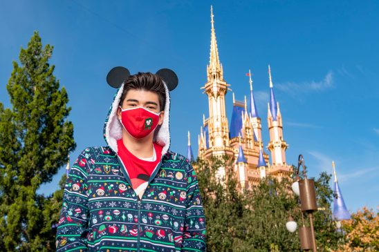 "TikTok ambassador Alex Ojeda gets into the holiday spirit at Magic Kingdom Park at Walt Disney World Resort in Lake Buena Vista, Fla., Thursday, Dec. 3, 2020, during a taping of ""The Disney Parks Magical Christmas Celebration."" The holiday special will air on ABC on Dec. 25, 10am-12pm ET. (Matt Stroshane, photographer)"