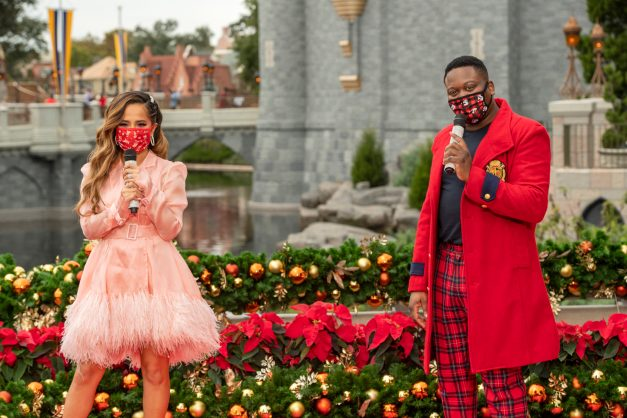 """Tituss Burgess, co-host of """"The Disney Parks Magical Christmas Celebration,"""" catches up with Becky G after her performance from Magic Kingdom Park at Walt Disney World Resort in Lake Buena Vista, Fla. on Friday, Dec. 4, 2020. The holiday special will air on ABC on Dec. 25, 10am-12pm ET. (Kent Phillips, photographer)"""