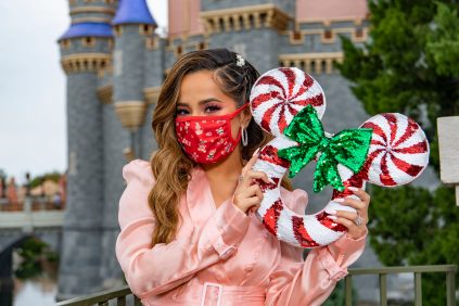 """Singer, songwriter, and actress Becky G celebrates the holidays at Magic Kingdom Park at Walt Disney World Resort in Lake Buena Vista, Fla., Friday, Dec. 4, 2020, during a taping of """"The Disney Parks Magical Christmas Celebration."""" The holiday special will air on ABC on Dec. 25, 10am-12pm ET. (Matt Stroshane, photographer)"""