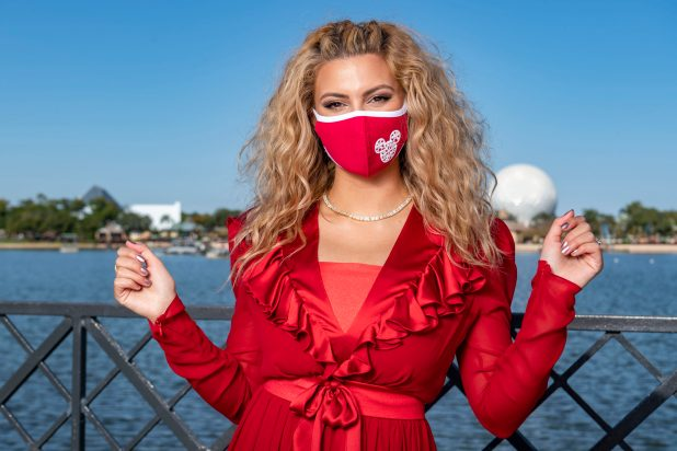 """Tori Kelly enjoys the holiday season at EPCOT at Walt Disney World Resort in Lake Buena Vista, Fla. on Saturday, Dec. 5, 2020, during a taping of """"The Disney Parks Magical Christmas Celebration."""" The holiday special will air on ABC on Dec. 25, 10am-12pm ET. (XXX, photographer)"""