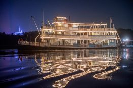 The Liberty Belle riverboat crosses in front of Magic Kingdom Park at Walt Disney World Resort in Lake Buena Vista, Fla., during an overnight repositioning following a nearly complete scheduled refurbishment. It was a rare sight to behold, as crews towed the 47-foot-tall classic steam ship back to her home in Liberty Square. (Kent Phillips, photographer)