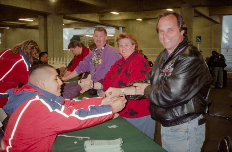 Steven W. Smith (right) receives the first wristband