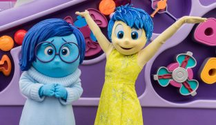 Joy and Sadness appear separately during A Touch of Disney - a new, limited-time ticketed experience that brings back some of the sights, sounds and flavors of the Disneyland Resort to Disney California Adventure Park beginning March 18, 2021. A Touch of Disney offers some of the world-famous food and drinks from around the Disneyland Resort, like churros, DOLE Whips¬, the mouth-watering Monte Cristo sandwich and more, plus a chance to see Disney characters, shop for the latest Disney merchandise and pop in at unique photo locations. The experience is underscored by a specially curated soundtrack of reimagined Disney songs broadcast throughout the park. (Joshua Sudock/Disneyland Resort)