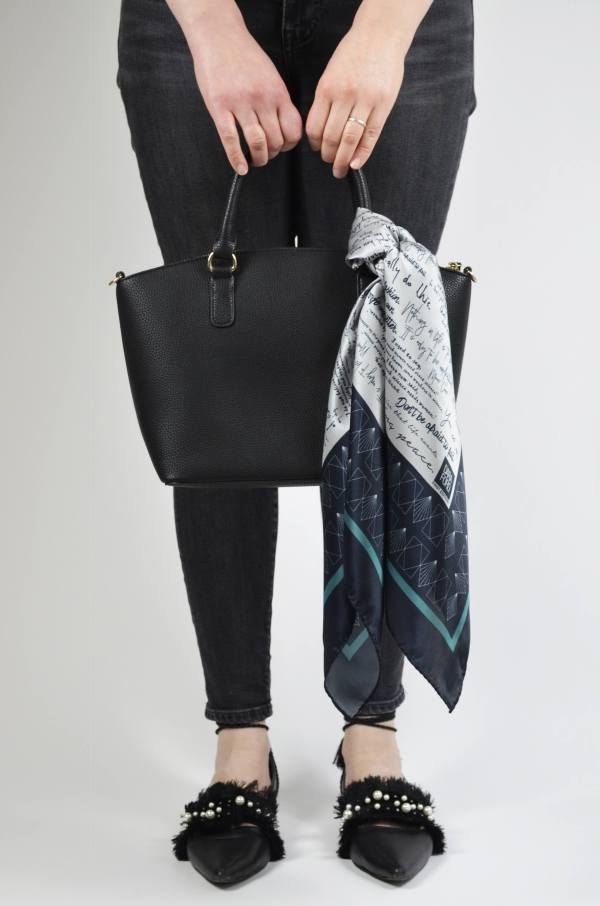 Front view of silk scarf tied onto bag