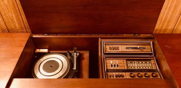 wood, knobs, sliders, and a turntable