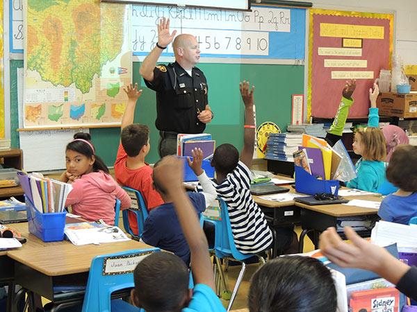 D.A.R.E Officer speaking in school classroom.
