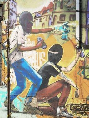 Two Graffiti Spray Painters