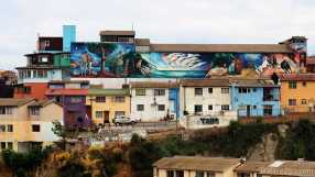 Valparaiso: this enormous mural is on the backwall of a school next to Pablo Neruda's house (left) - best seen from a distance along Av.Alemania