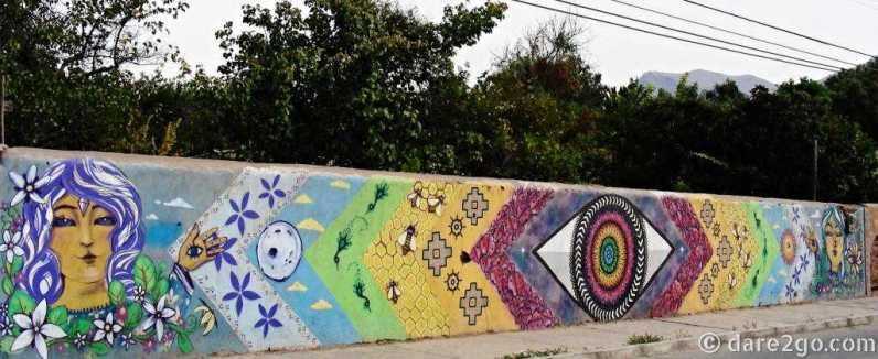 Vicuña: long wall with Mandala style streetart