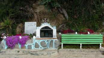 "Quintay: shrine at beach parking lot, dedicated to ""Grande Kike""."