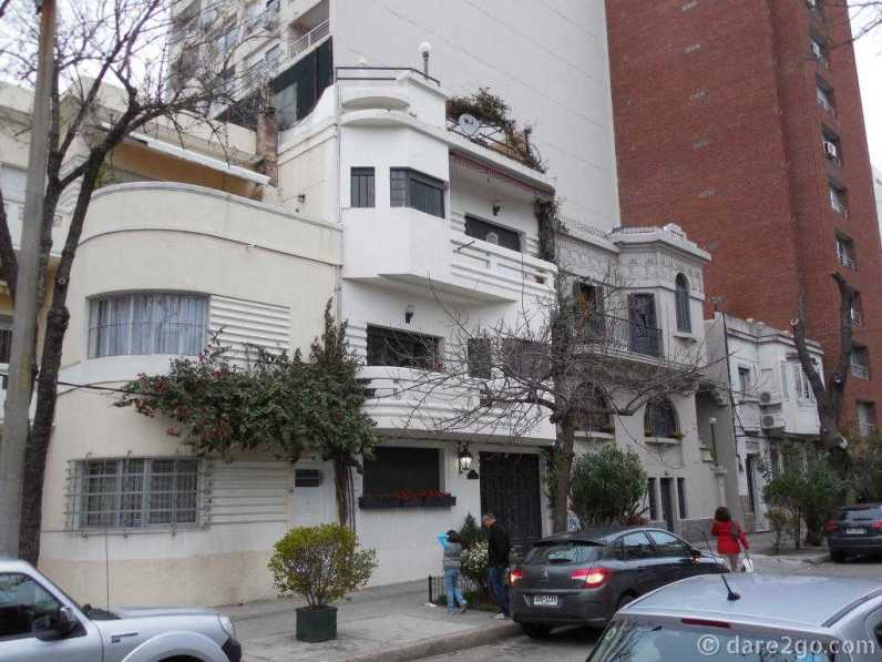 Montevideo, in a side street: a row of Art Deco houses surrounded by new high-rise apartments.