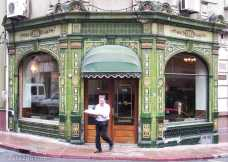Montevideo: facade of a corner cafe in the old part of town. Classic Art Nouveau tiles.