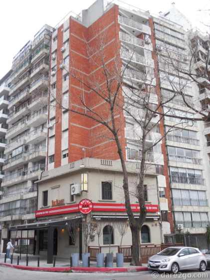 Montevideo: it looks like this corner property refused to sell. Hence, now this flourishing corner pub is surrounded by high-rise apartments.