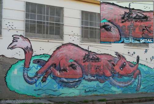 StreetArt in Argentina: section of the long wall in Gualeguaychu. See some of the detail in the top right.