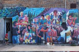 A close-up of the mural at the ice cream parlor. This depicts the colourful village life nicely.