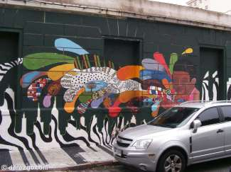 In a side street of Calle Yaguaron, Montevideo. Don't you agree that parking in front of street art should be forbidden?