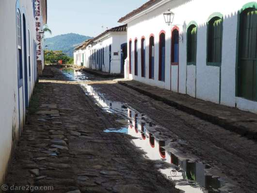 Paraty: a row of houses reflecting in the water left behind by the last high tide.