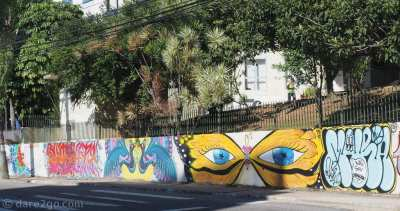 A long street art wall on the outskirts of the city of Florianópolis.