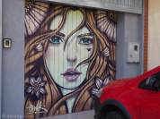 Isn't this a stunning garage door? (The same artist as our header photo.)