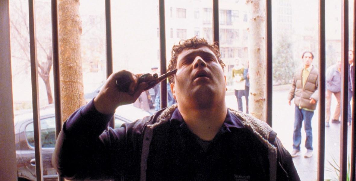 Hossain Emadeddin in Jafar Panahi's 2003 film Crimson Gold